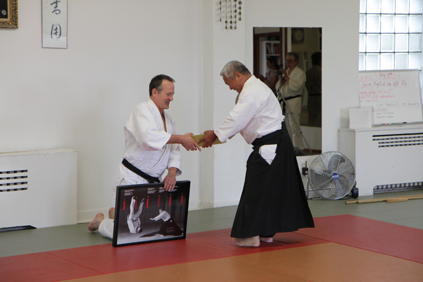 Kimeda Sensei presenting Hans DeGroot with gifts for the 20th Aniversary of AYO.